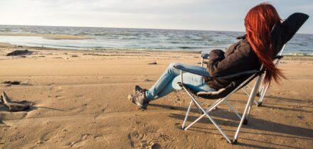 woman-sitting-on-deckchair